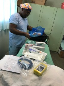 Dr Jack Puti anaesthetist unpacking gear